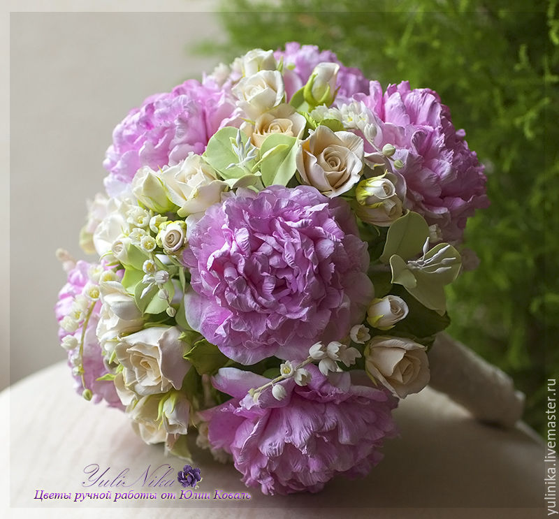 Bouquet of the bride with peonies