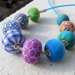 Mosaic hollow lentil bead necklace