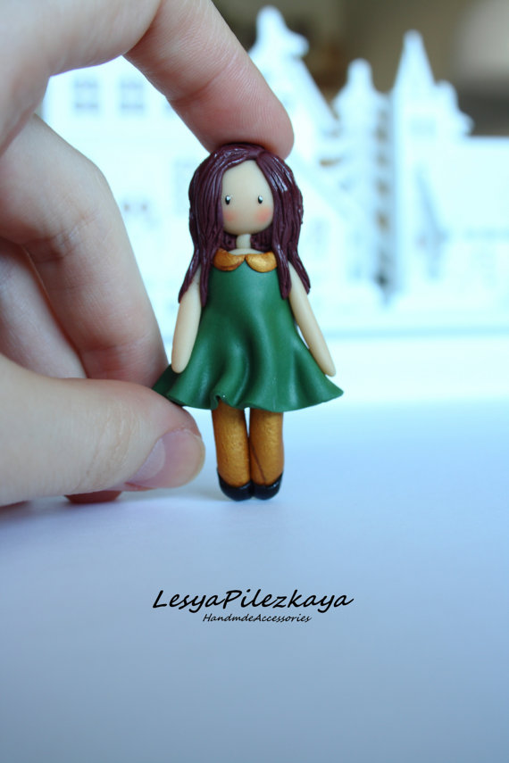 Polymer clay brooch little girl in green
