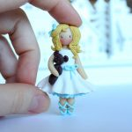 Polymer clay brooch little girl in yellow + lilac dress with tulips