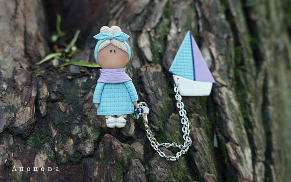 Polymer clay double brooches - dolls with a toy