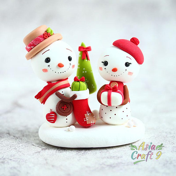 snowman prepare gift in christmas stocking clay figure snowman hold xmas present with christmas tree clay miniature christmas decoration