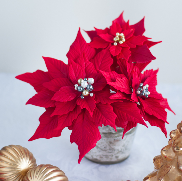 Polymer clay Christmas decorations with poinsettias 2